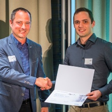Award presented to David Maier by Dr.-Ing. Michael Schwan